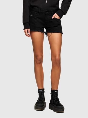 Cut-off shorts in washed denim