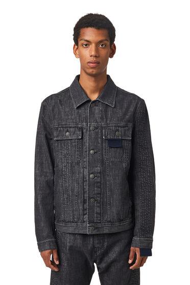 Overstitched denim trucker jacket